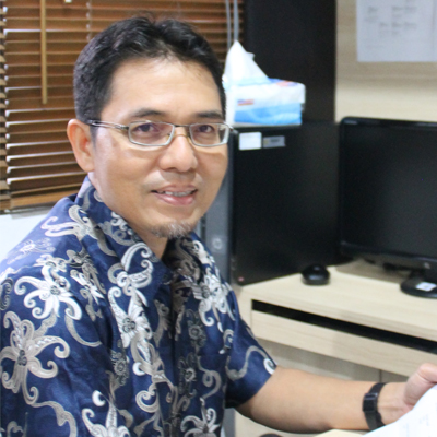Amri Yusra, Drs., M.Si